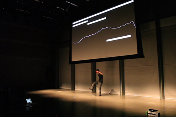 "A ""human synthesizer."" The student's movements control the pitch and volume of a series of notes. The screen displays a real-time visualization of the sound."